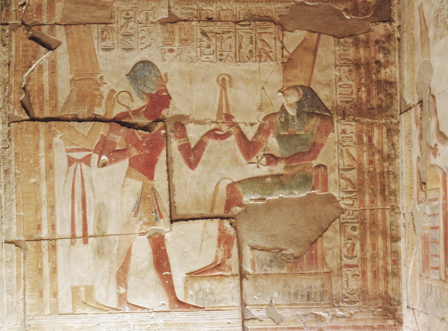 Seti I making offerings to Horus - Raised wall relief, First osiris hall.