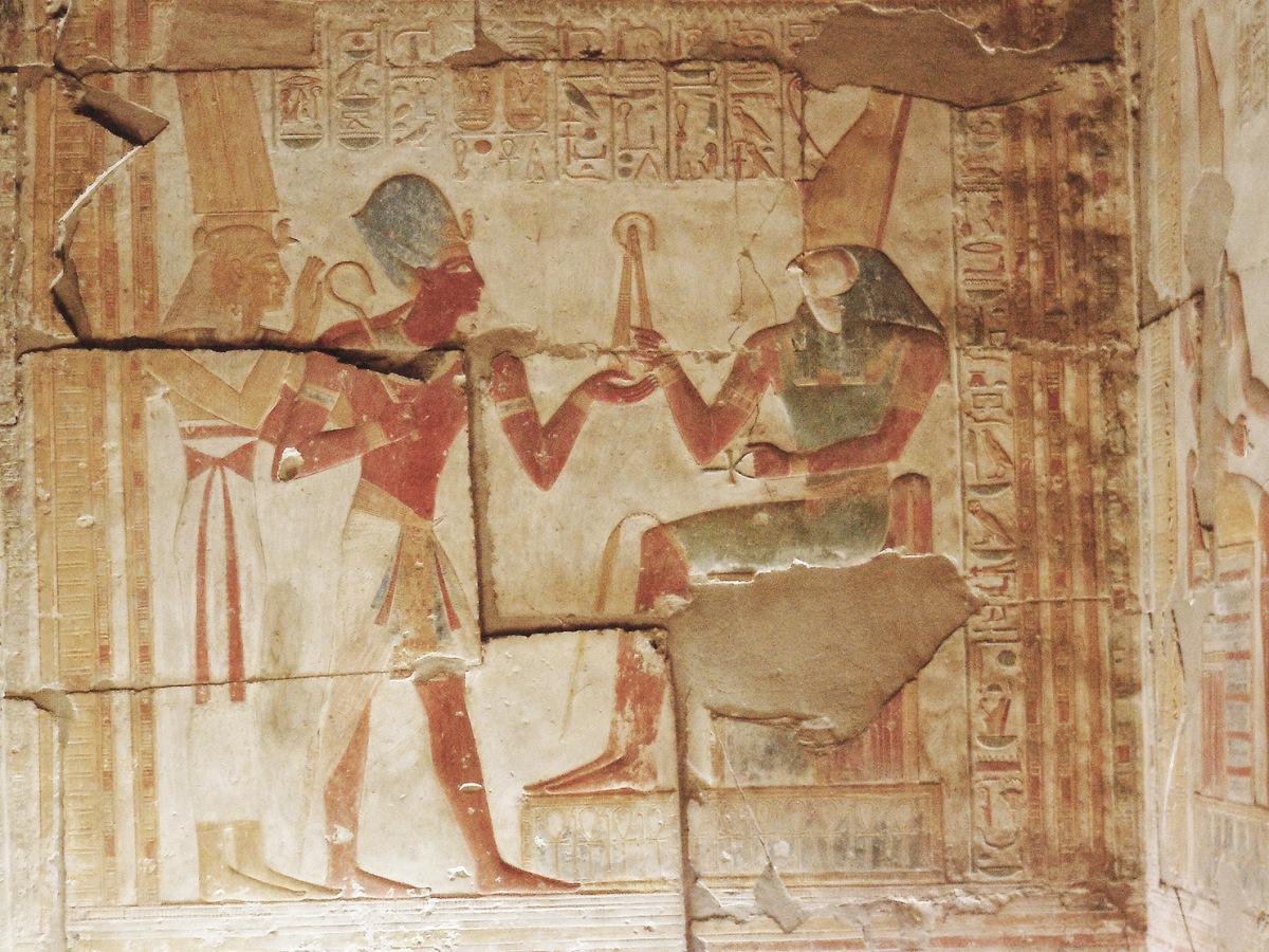 Seti I making offerings to Horus