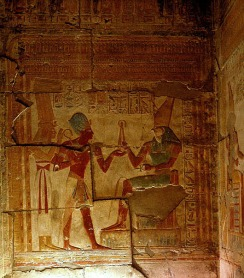 Seti I's offerings to Horus being blessed by Isis, Abydos