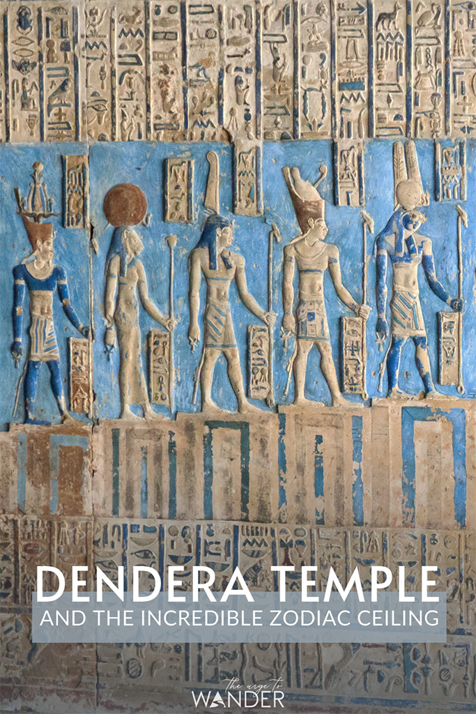 Close up of row of Egyptian deities in the turquoise ceiling of the temple of Hathor in Dendera.