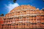 """Hawa Mahal or the : """"Palace of Winds"""" is a narrow palace, almost a facade, with 953 small windows called jharokhas decorated with intricate latticework. The original intention of the lattice was to allow royal ladies to observe everyday life in the street below without being seen, since they had to observe strict """"purdah"""" (f"""