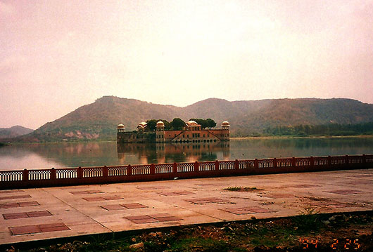 "Jal Mahal (meaning ""Water Palace"") is a palace located in the middle of the Man Sagar Lake. This image was taken before it was restored."