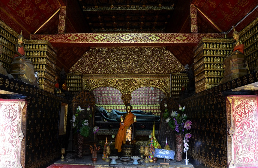 Ancient bronze reclining Buddha in the Chapel Rouge
