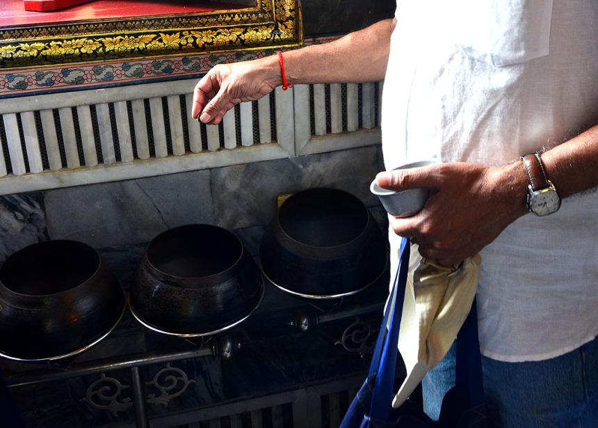 Coin offering - Wat Pho, Bangkok