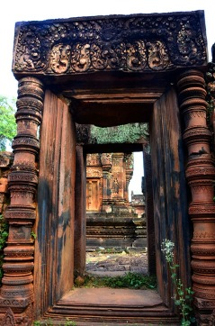 View through a doorwayAnimal headed Dwarapalakas (guardians), Banteay Srei - Siem Reap, Cambodia