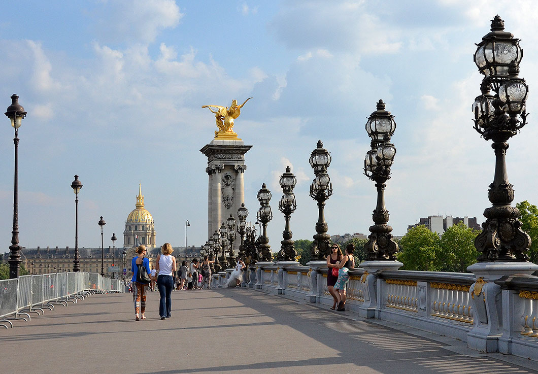 Walking across the Pont Alexander III