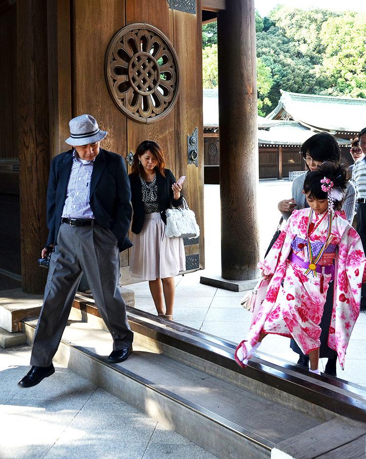 Crossing a threshold in Meiji Jingu, Japan