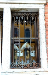 Masks in window, Venice