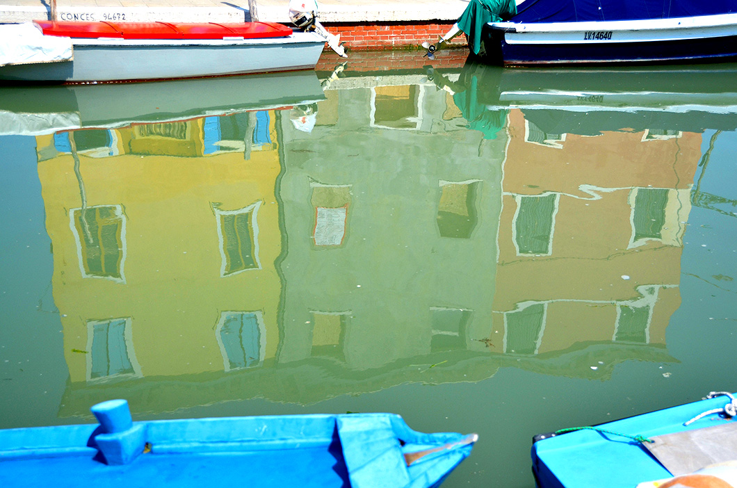 Reflection of Yellow, Green and Orange houses in the canal.