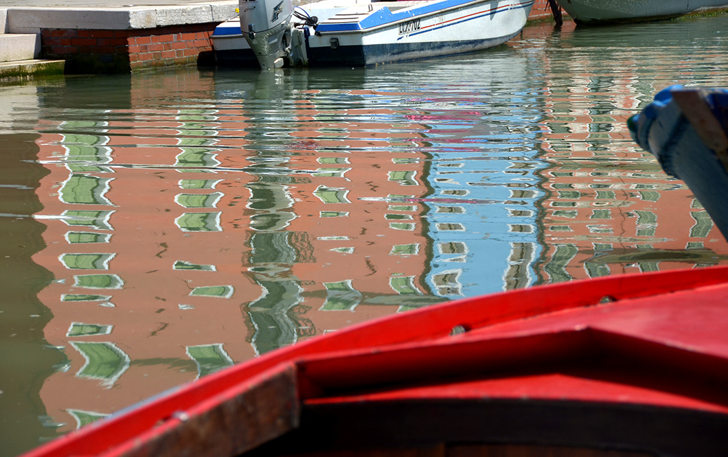 Reflection of Red and blue houses in the Burano Canal