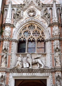 Doge Francesco Foscari recieving divine approval from the winged lion of Saint Mark - above the Porta della Carta to the Palazzo Ducal.