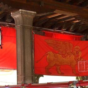 Lion on a red flag at the Rialto Pesceria