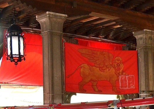 Lion on a red flag at the Rialto Pesceria
