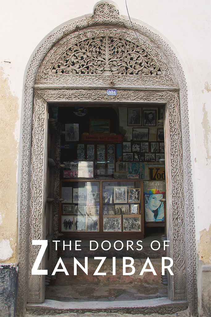 Doorway of Ojha Photo Studio in Zanzibar: The carved wooden doors of Stone Town, Zanzibar are striking reminders of the island's affluent past and a cultural heritage worth exploring.