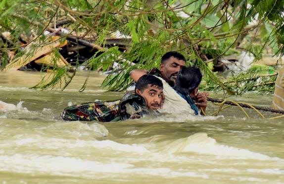 Indian army soldiers rescue a man from flood waters in Chennai, India, Thursday, Dec. 3, 2015. The heaviest rainfall in more than 100 years has devastated swathes of the southern Indian state of Tamil Nadu, with thousands forced to leave their submerged homes and schools, offices and a regional airport shut for a second day Thursday.( R Senthil Kumar / Press Trust of India via AP) via Indian Express