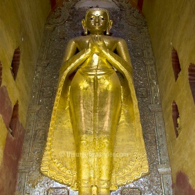 "One of two original 11th century 9.5 mt tall standing Buddhas in the Ananda temple. This faces North. Two more replicas face East and West. Ananda Paya is considered the ""finest, largest, best preserved and most revered of Bagan temples."". The crowds are proof."