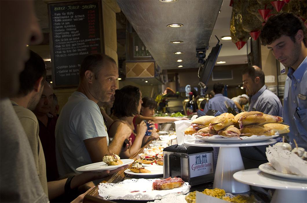 A crowded pintxo bar in San Sebastian old town.