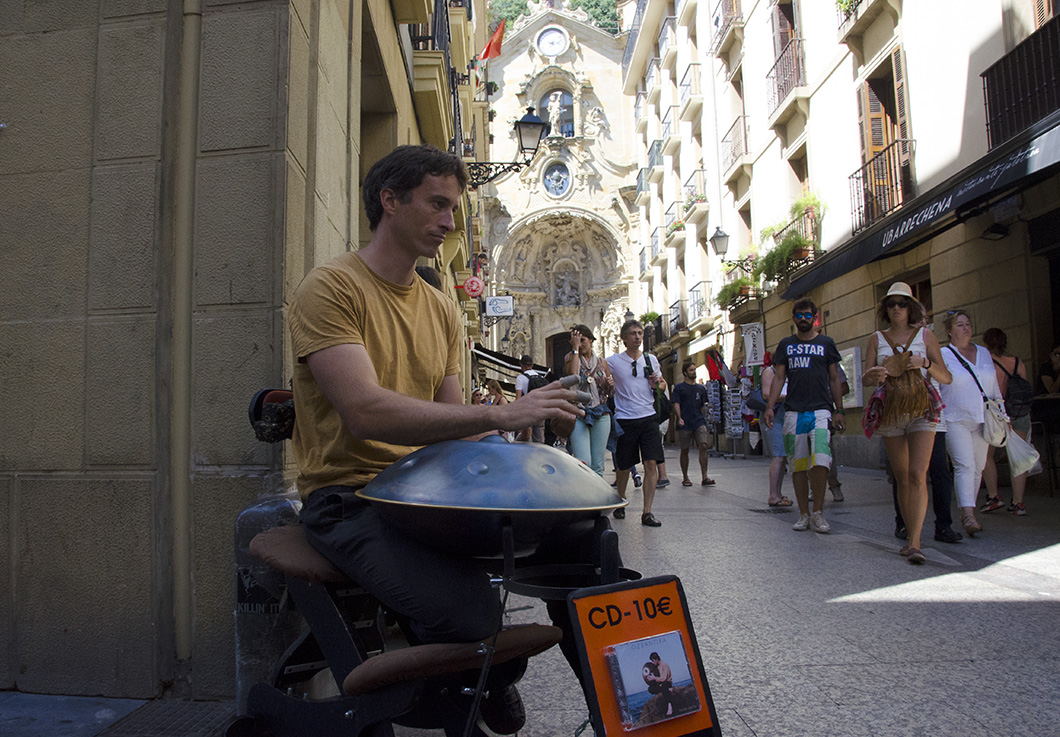 A busker plays the handpan on a corner of the Calle Mayor- Old Town, San Sebastian