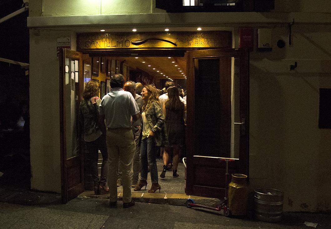 Looking into a buzzing La Cuchara de San Telmo pintxo bar from the street.