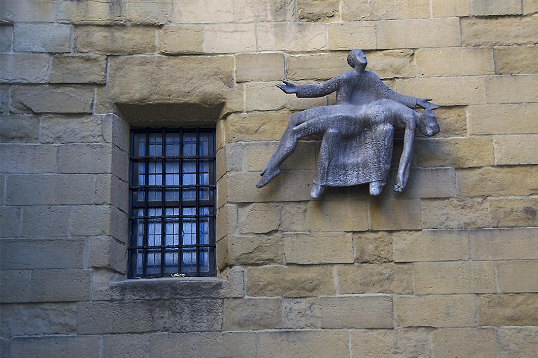 Stark, modernist Pieta suspended on the facade of San Vincent Church, San Sebastian