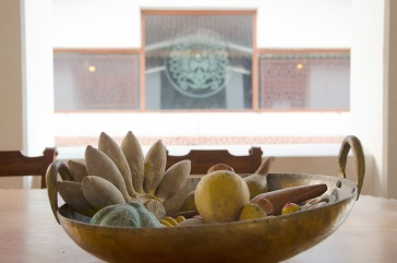 Wooden fruit tray on a terrace table.