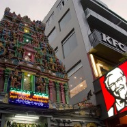 A KFC sign clashes with a Hindu temple spire.