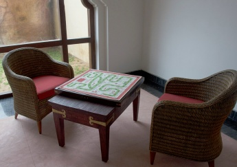 Lounge with traditional indoor games. Just outside is the children's play area.