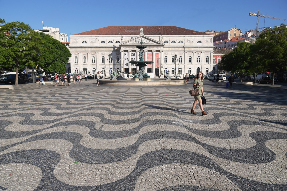 Mosaic tile pattern titled 'The Wide Ocean' on Rossio Square, Lisbon.