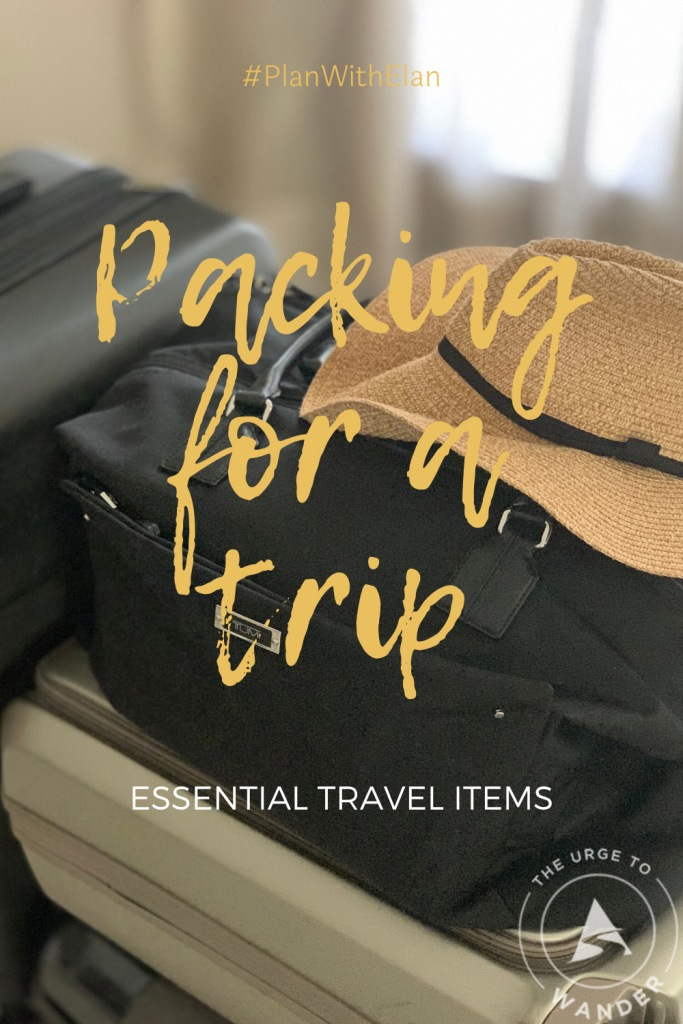 Four suitcases and straw hat - Pinterest Pin