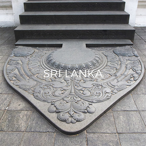 Carved Moonstone threshold slab in the temple of the tooth relic, Kandy. Image link to Sri Lanka Guide