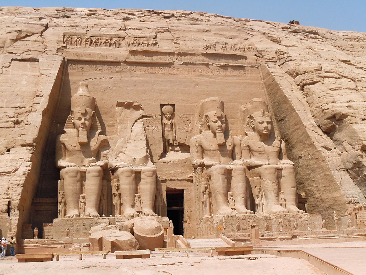 Facade, Temple of Ramesses II. Statues on either side of and between Ramesses's knees are those of Nefertari and their favourite children.