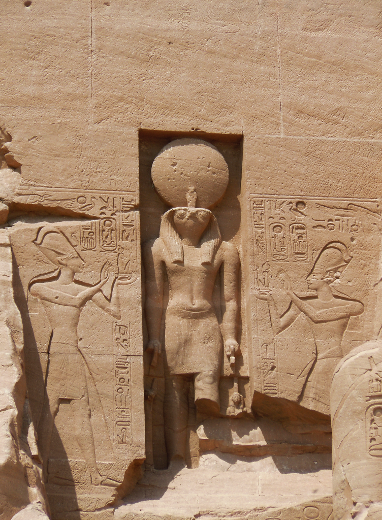 Statue of Ra Horakhty, the Sun God above entrance to Abu Simbel Temple.