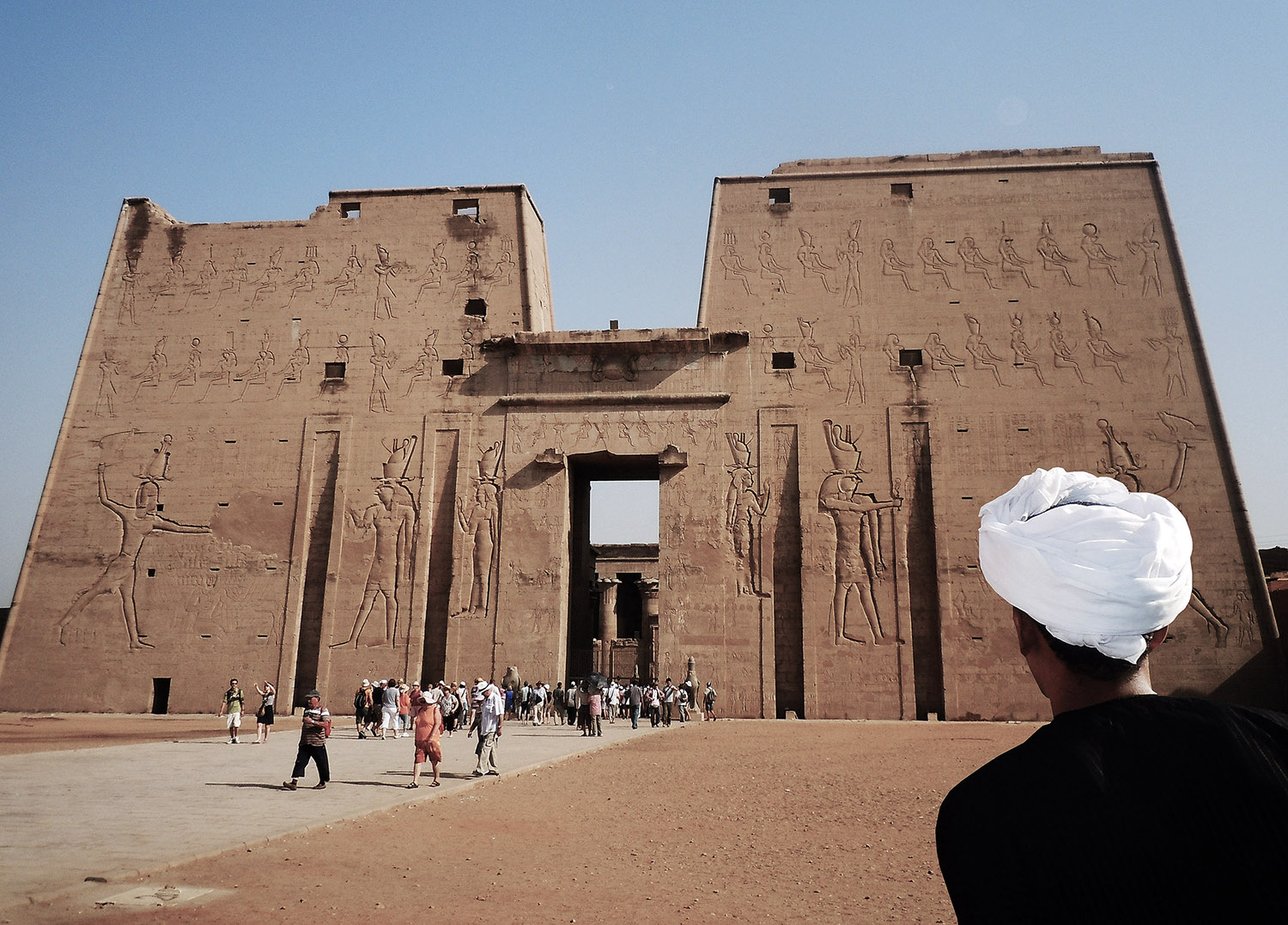 Local man in white turban in front of the Temple of Edfu