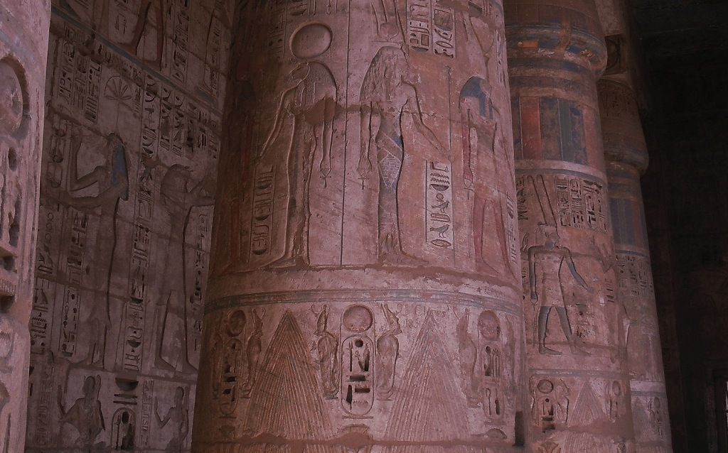 Row of columns with carved reliefs in Medinet Habu.