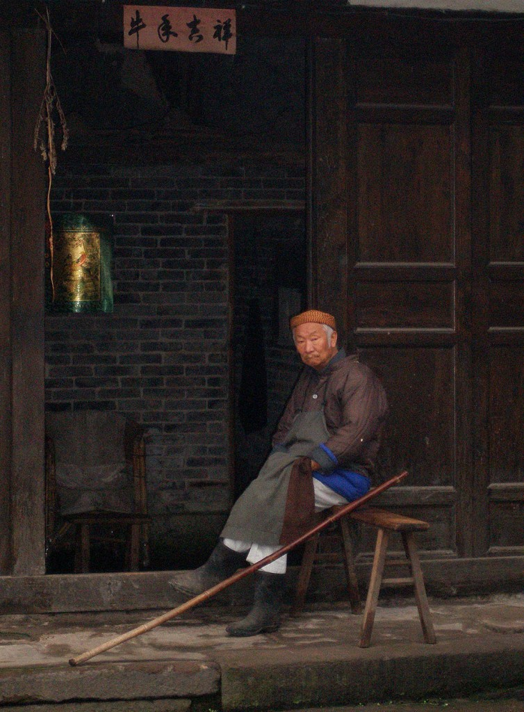 Old butcher outside his shop in Laitan, China