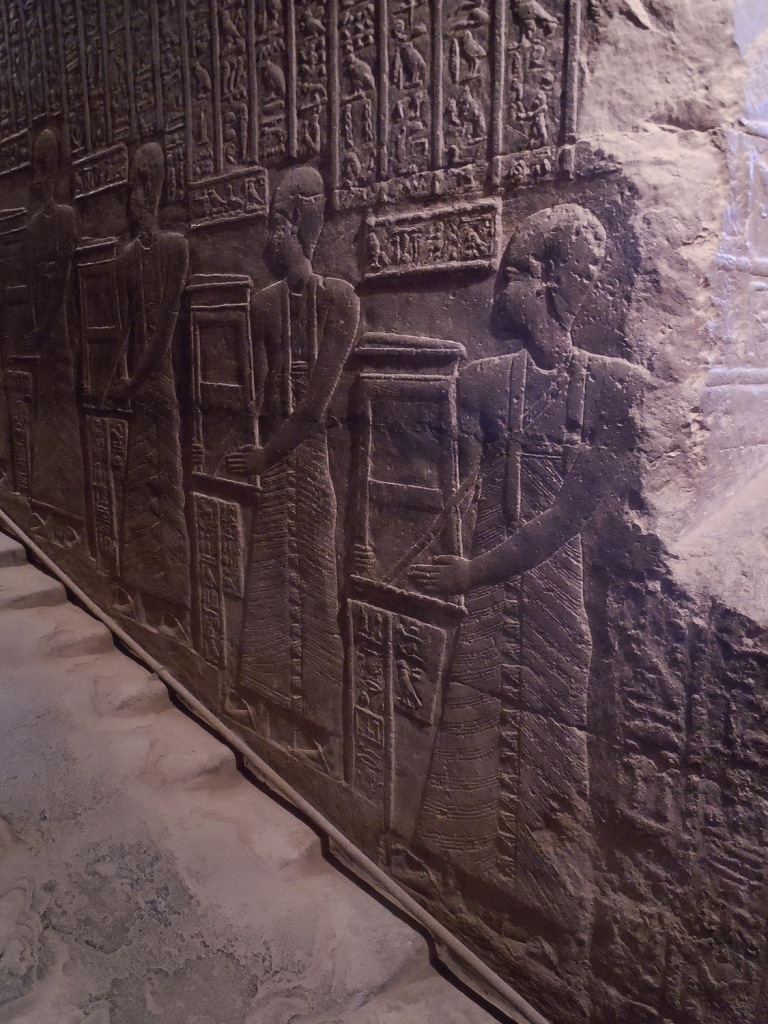 Relief on opposite wall of priests  ascending the  procession staircase.