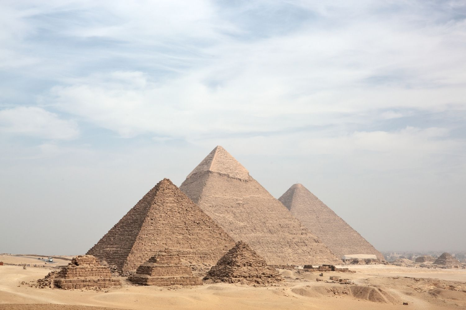 Panoramic view of the three pyramids of Giza along with the three satellite pyramids in front.