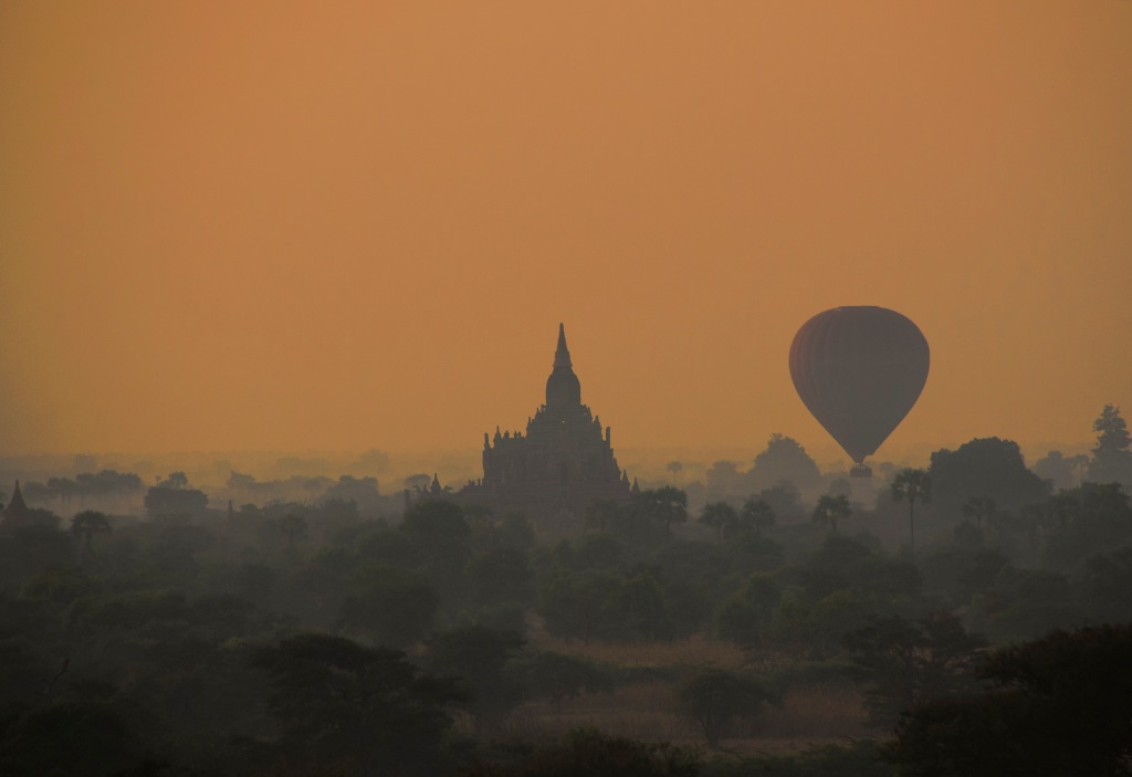 Dawn silhouttes of a balloon and pagoda viewed from the top pf Pyathatgyi) stupa.