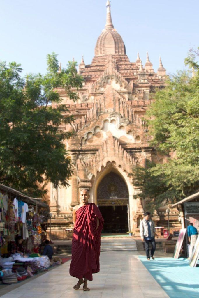 Monk in front of Htilominlo Temple.