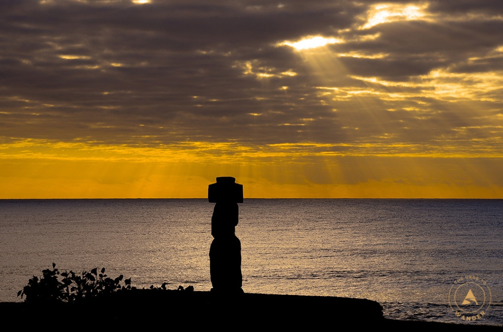 Silhouette of the moai, Ahu Ko Te Riku, at sunset in Hanga Roa, Easter Island.