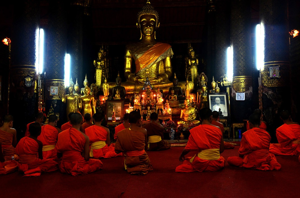 Monks at prayer in Wat Mai, Luang Prabang
