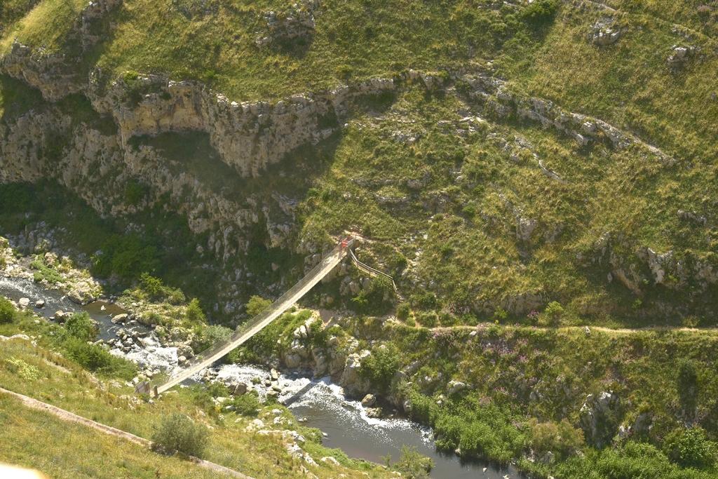 Rope bridge across the ravine in Matera.