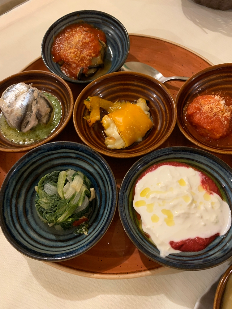 A selection of six traditional antipasti in a restaurant in Matera.