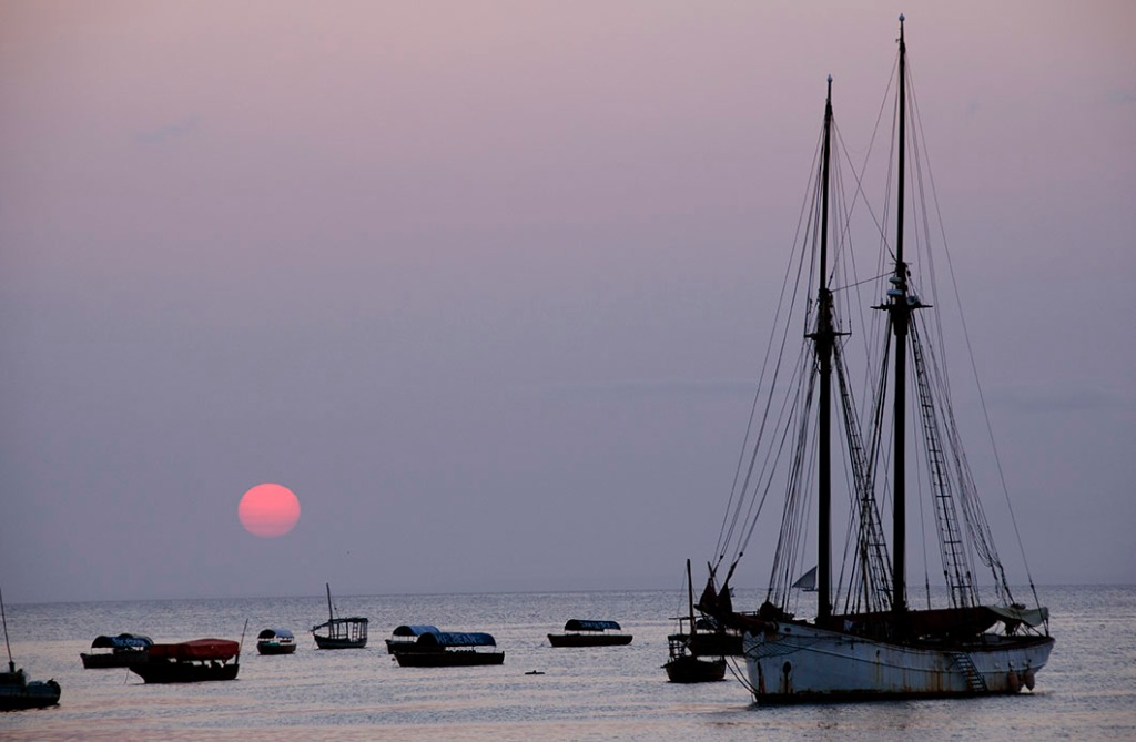 Zanzibar sunset - a lilac sky with a red orb - Stone Town Travel Guide