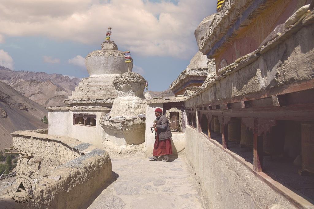 Red robed lama amid the chortens of Lamayuru Monastery, Ladakh