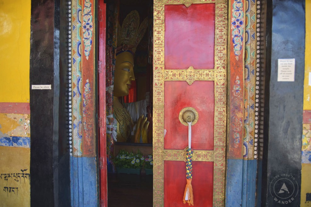 A glimpse of the Maitreya 9future Buddha0 through the brightly painted door In Thiksey Monastery.