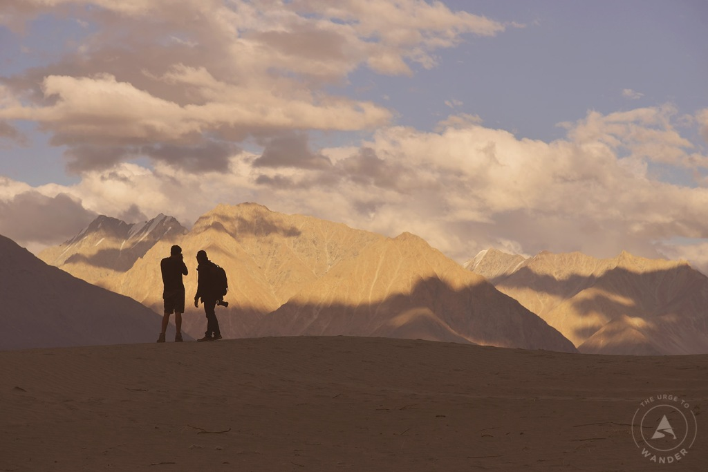 Silhouettes of two fellow travel mates on the sand dunes of Hunder.