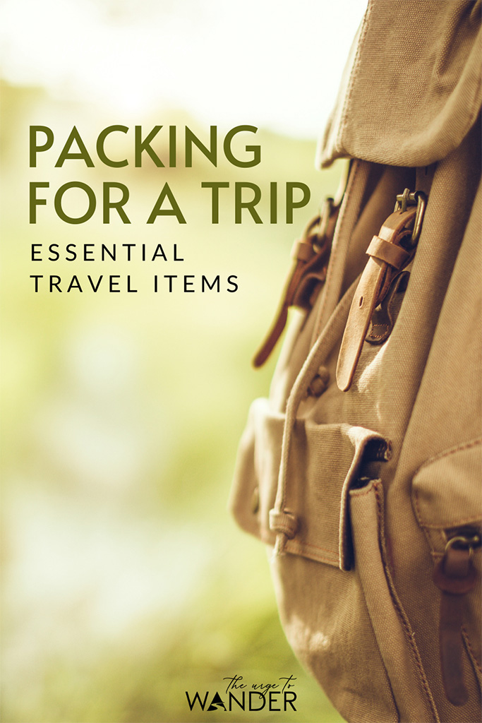 Brown canvas backpack. What's in our travel bags? Here's the complete checklist of our essentials travel items including electronics and photography gear. #PackingList #TravelGear