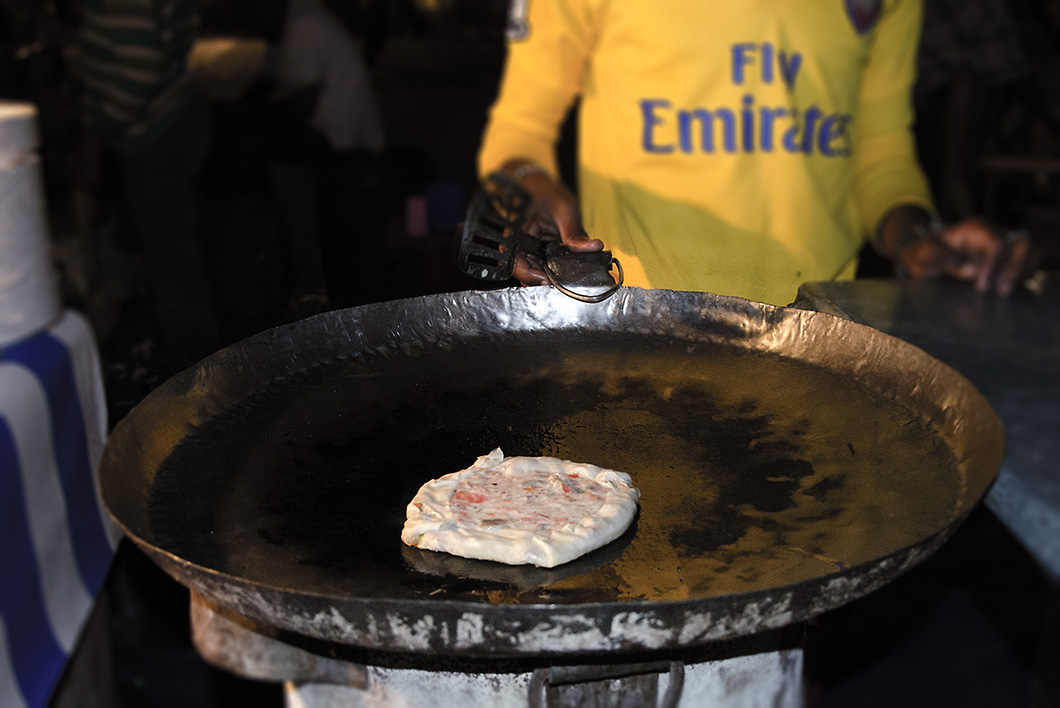 Zanzibar Pizza being fried on a skillet - Stone Town Travel Guide