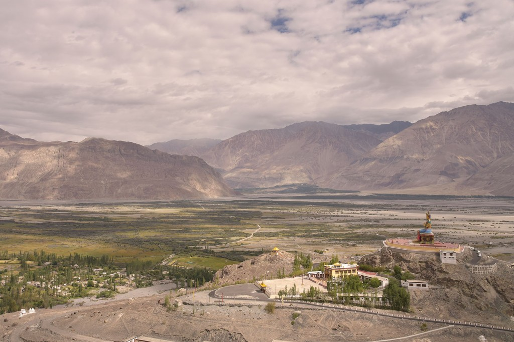 View from Diskit Gompa of the 32 metre tall Maitreya dwarfed by the landscape.